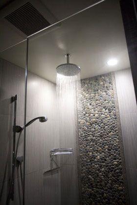 Zen shower using Bali Ocean pebble tile as accent piece.  https://www.pebbletileshop.com/products/Bali-Ocean-Pebble-Tile.html#.VgwKXBFViko