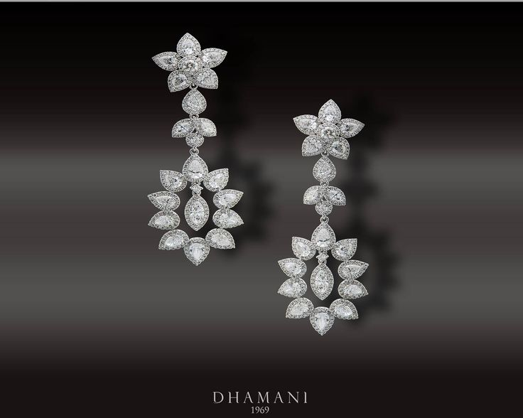 Dazzling #Diamond #Earring weighing 16.95 grams with 18K White Gold, studded with 2.60 carats of Natural Round #Diamonds and 6.26 carats of Fancy #Diamonds- At Dhamani The Dubai Mall #Dhamani1969 #luxury #NaturalBrilliance #mydubai