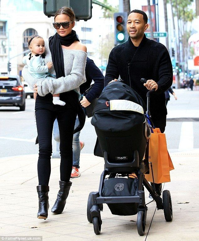 Last minute gifts? On Friday Chrissy Teigen stepped out with husband John Legend and eight-month-old daughter Luna for some pre-Christmas shopping in Beverly Hills... - Celebrity Street Style
