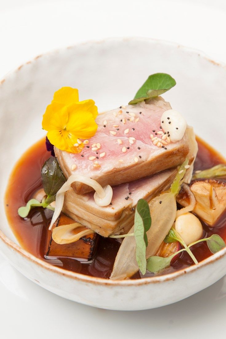 A stunning seared tuna recipe by Aaron Patterson, this Japanese main course pairs marinated tofu with tuna and mixed mushrooms.
