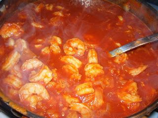 Camarones a la Diabla! 2 Guajillo chile peppers 5 Arbol chile peppers 5 Serrano chile peppers 1 28-oz Can tomato puree  1 Stick of butter 1 Medium onion, finely chopped 1/2 Head of garlic, minced  2 Lbs prawns, peeled and de-veined, tail intact Salt to taste