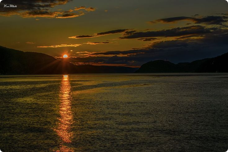 Saguenay Fjord Sunset, Quebec.  The steep sides of the Saguenay Fjord provide a superb background to the setting sun and a perfect end to the da