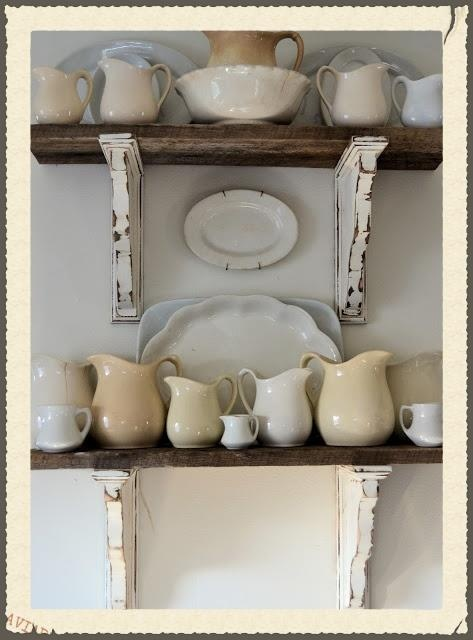 white ironstone collection displayed on repurposed wood shelves