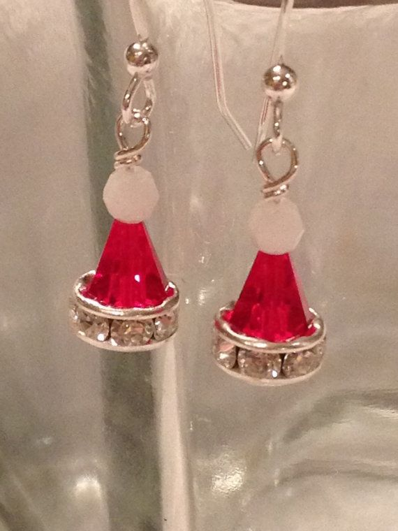 Swarovski Crystal Santa hat earrings by acalabro18 on Etsy - Made with sterling silver findings and light Siam and alabaster Swarovski crystals, they are sure to make any day jolly!