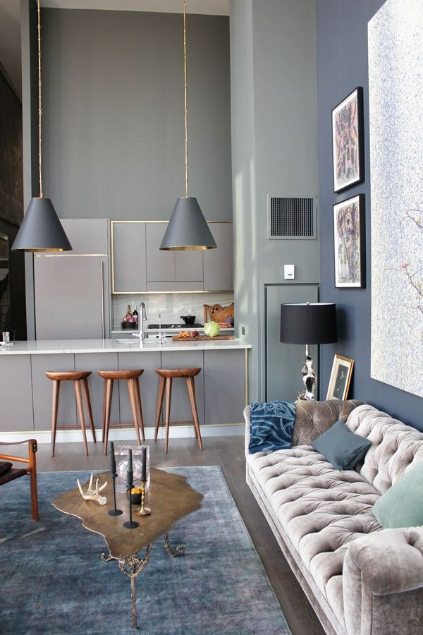 Duplex Penthouse | S t a r d u s t - Decor & Style gray tufted sofa... blue and brown accents