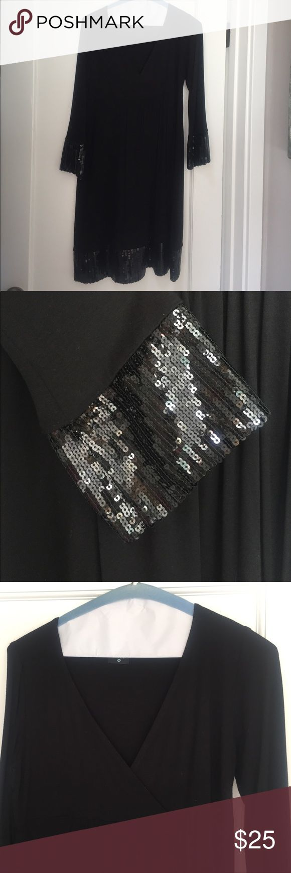 Olian Maternity black cocktail mini-dress Gorgeous, black Olian maternity dress in M. This is the most flattering, classic maternity dress! Empire waist, sequin details at the wrists and hem. In excellent used condition! Worn once. Olian Dresses Long Sleeve