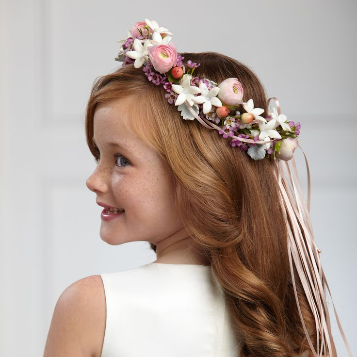 The FTD® Lila Rose™ Headpiece will make any flower girl glow. Pink ranunculus, white stephanotis blooms, pink waxflower, peach hypericum berries and dusty miller stems are arranged in the perfect circle and accented with peach satin ribbon to crown her head on the wedding day, giving your flower girl a sweet look for her big moment. #flowergirl #weddingflowers