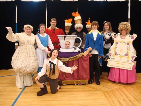 article with picture of cast from school performance of beauty and the beast jr