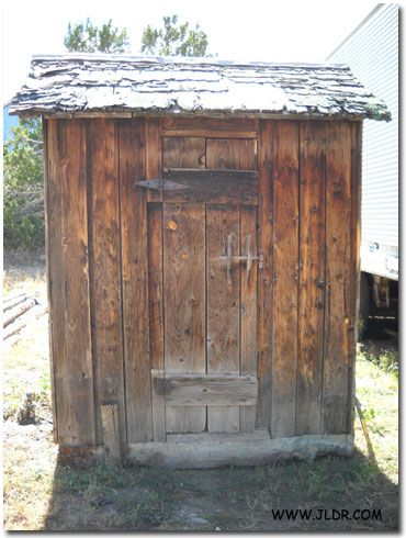 "From the outside, this outhouse very much looks like the two-seater that was in use at my grandpa's house until about 1968.  (Some still used it afterward, if someone was using the ""indoor"" toilet.)"