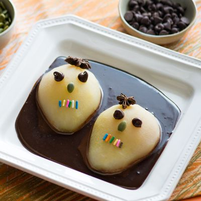 Calavera Pears in Chocolate Coffee Sauce – A hauntingly-fun recipe to celebrate Halloween or Dia de Los Muertos with the family. The kids will love helping to decorate these!