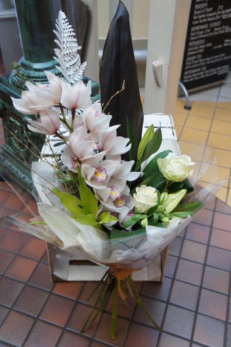 Winter wonderland bouquet including exotic orchids