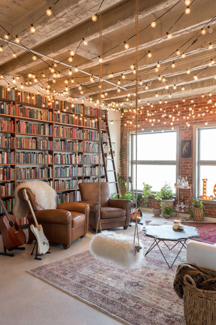 Loft living. Would be cool to try this some day. I'd include bookshelves like this. Love the string lights across the ceiling too!