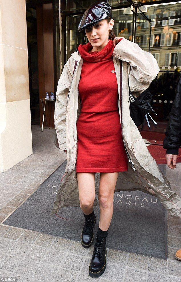 Legs for days:The brunette beauty appeared unfazed by the chilly weather as she stepped out in the mini dress - which pulled into a cosy roll neckline, but cut off high at her thigh