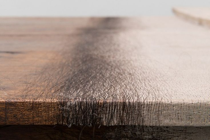 Doris Salcedo, Unland: the orphan's tunic (detail), 1997. Wooden tables, silk, human hair, and thread.