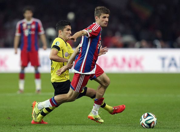 Nuri Sahin (L) of Borussia Dortmund and Thomas Mueller of Bayern Muenchen vie for the ball during the DFB Cup Final match 2014 between Borussia Dortmund and Bayern Muenchen at Olympiastadion on May 17, 2014 in Berlin, Germany.