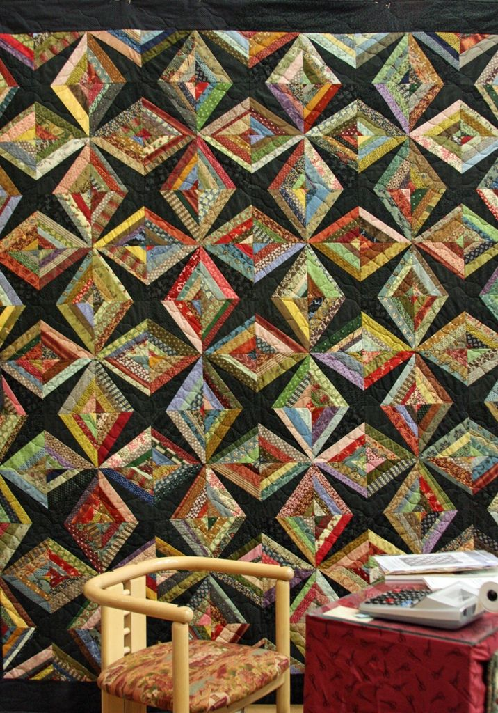 Scrappy String Quilt.an interesting placement of fabrics gives a star shape on the finished quilt