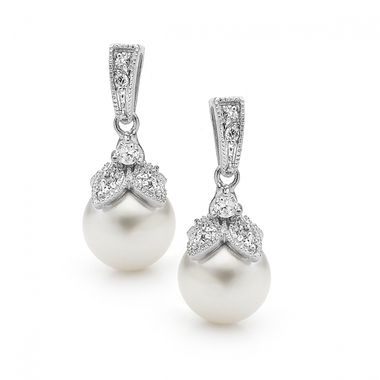 The Forever earrings are beautifully classic earrings featuring sparkly cubic zirconia crystals (cut to sparkle like diamonds) and natural lustre man-made pearls.  Height 2.3 cm x Width 0.9 cm.  Plated in tarnish resistant rhodium (part of the platinum family of metals).