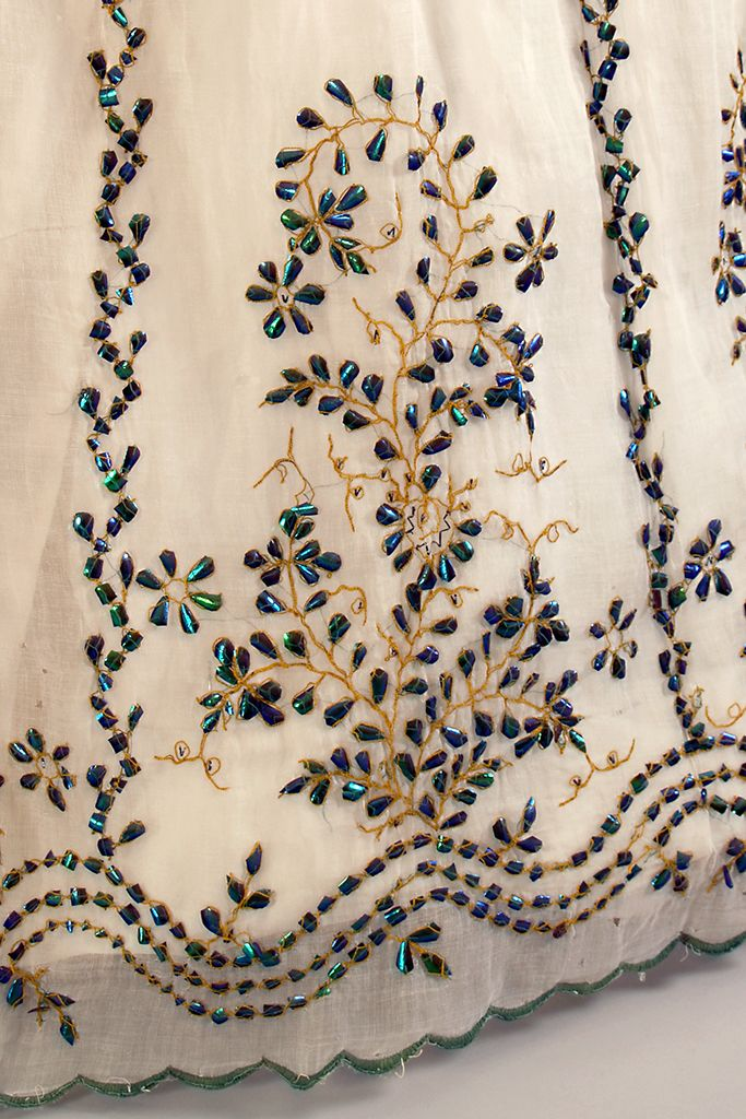 Detail of beetle wing embroidery on white cotton gauze dress, embroidered in India for export, ca 1865, KSUM 1983.1.98.