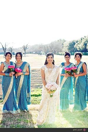 Blue and gold bridesmaids with pink bouquets for an Indian bride's Hindu fusion wedding.