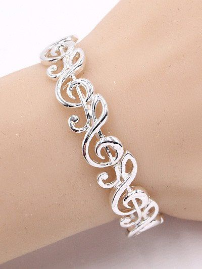 Silver tone treble clef stretch bracelet. One size fits most.