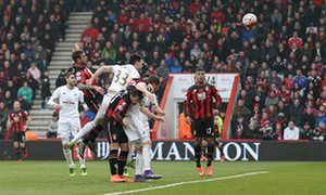 Bournemouth close in on safety after Steve Cooks header sinks Swansea