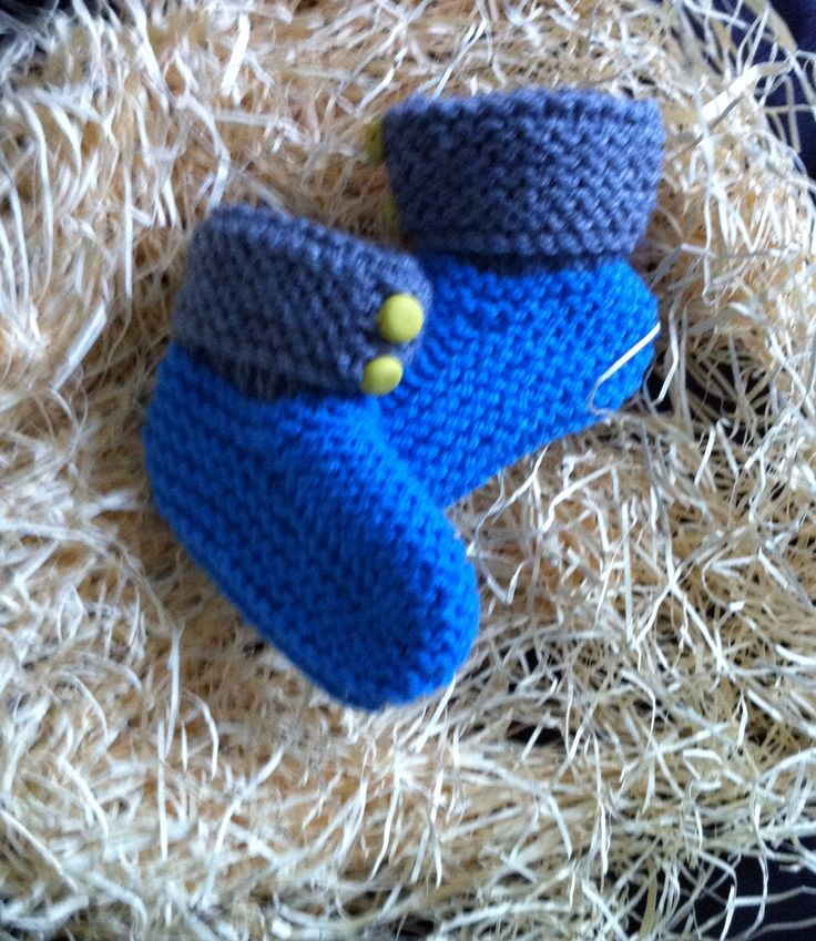 Blue and grey booties with yellow buttons. Size 0.