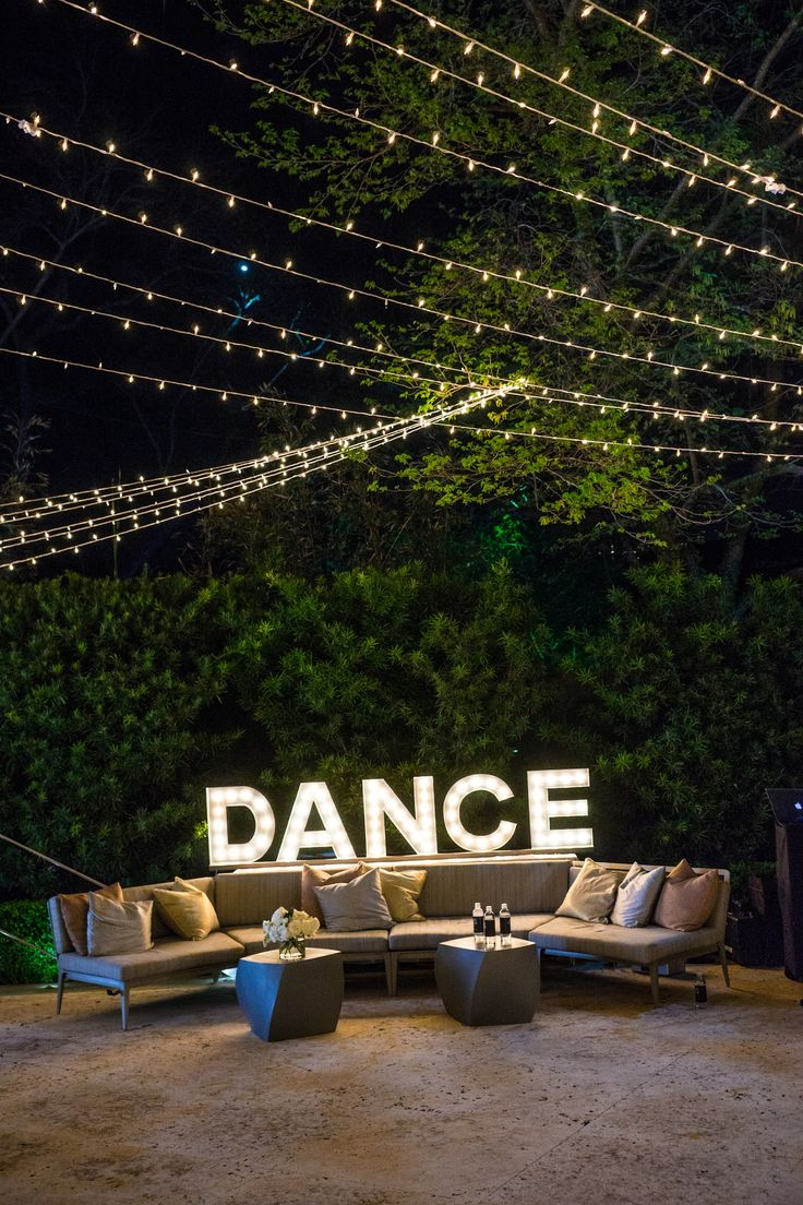 D-A-N-C-E Marquee Lighting | Photography: Robert Evans Studios. Read More: http://www.insideweddings.com/weddings/an-austin-texas-lake-house-wedding-with-a-natural-color-palette/568/