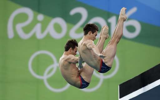 Britain's Tom Daley, left, and Daniel Goodfellow, right, compete during the men's synchronized 10-meter platform diving final in the Maria Lenk Aquatic Center at the 2016 Summer Olympics in Rio de Janeiro, Brazil, Monday, Aug. 8, 2016. (AP Photo/Wong Maye-E)