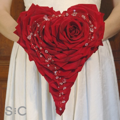Red silk rose petal heart, with a curl of crystals