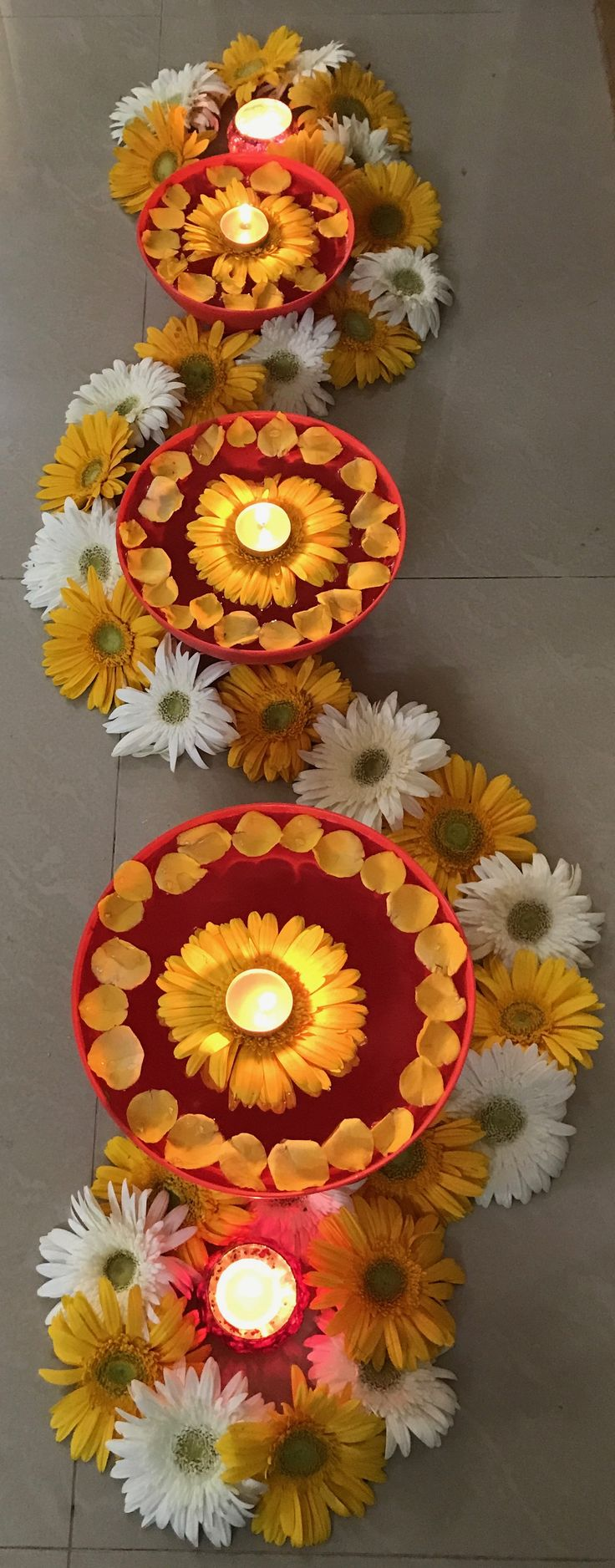 Beautiful and innovative yellow n white flowers arranged in decreasing order for Diwali festival.