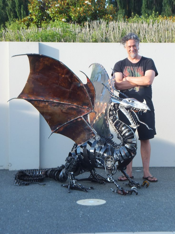 Marti with his Dragon. Recycled Steel and copper. Marti Wong Sculpture.
