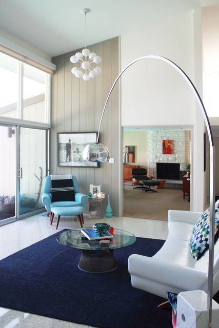 mid-century living room. love the blue arm chair + pendant lamp. #designpublic