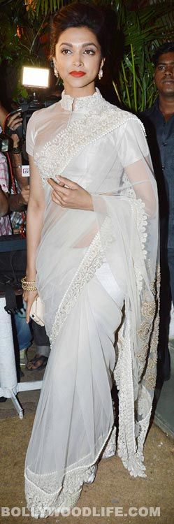 Can she get any more perfect? Love the way she carries her saris. tall and statuesque.