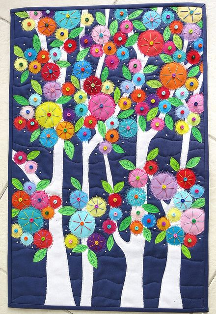 """Flowers in the Forest"" by Carol at mamcjt at Flickr.  This 14x21 1/2 quilt is both machine and hand quilted with the addition of over 100 tiny buttons, plus white french knots to give a mystical affect.  Lovely."