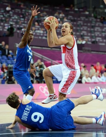 Russian guard Becky Hammon (C) is challenged by French guard Celine Dumerc (ground) and French guard Emilie Gomis (L) during the London 2012 Olympic Games women's semifinal basketball game bewteen Russia and France at the North Greenwich Arena in London on August 9, 2012. AFP PHOTO /MARK RALSTONMARK RALSTON/AFP/GettyImages Photo: MARK RALSTON, AFP/Getty Images / AFP