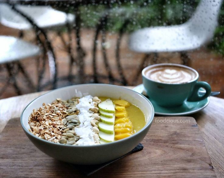 "#Bali start this morning with @SproutBali's delicious smoothies bowl ""Sunbird"". Whats inside: mango apple coconut cashew nut pumpkin seeds granola."