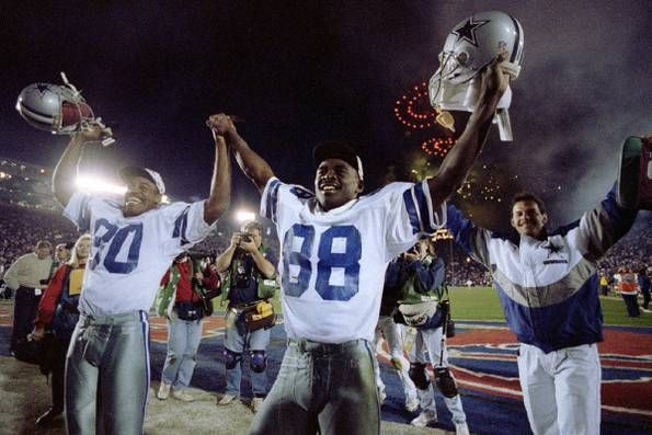 Dallas Cowboys Alvin Harper and Michael Irvin celebrate after the Super Bowl XXVII as fireworks go off behind them in the Rose Bowl in Pasadena, Calif. on Jan. 31, 1993.