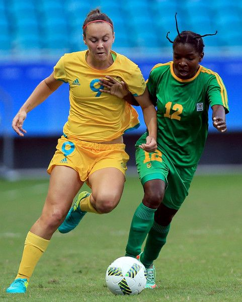 Foord of Australia runs with the ball against Nyaumwe of Zimbawe during the match between Australia and Zimbabwe at the Rio 2016 Olympic Games at Arena Fonte Nova on August 9, 2016 in Salvador, Brazil.