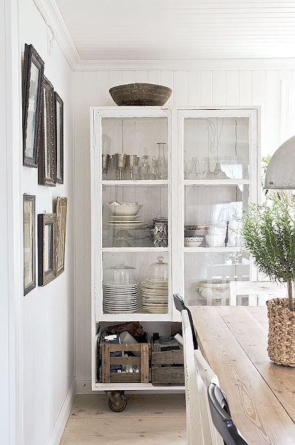 Love the feel of this space-white walls, weathered woods, stacks of dishes.  Urban Cottage Kitchen