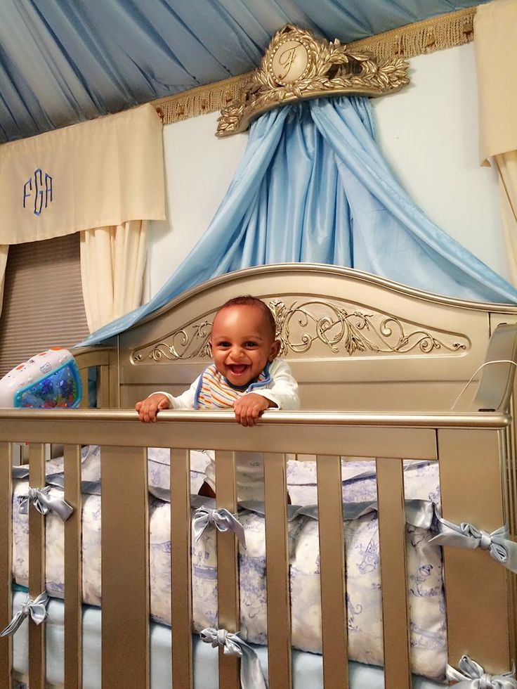 The Ultimate Prince's Nursery- full of lavish curtain, luxurious baby bedding, and all things gold and baby blue. This little prince loves his Chelsea Lifetime in Antique Silver. Shop this look on our site and get his crib and a Chelsea Wall Crown of your own!