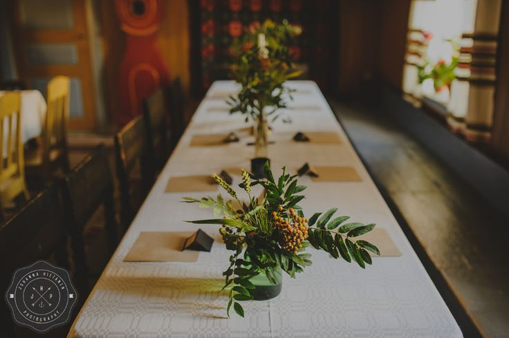 DIY wedding flowers for tables made from wild rowan branches and crops.
