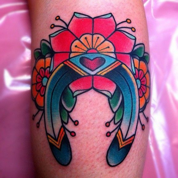 Nice colors for this old school tat by Alex Strangler.