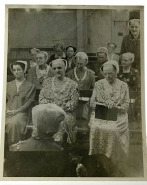 "Canterbury Shaker Sisters at service with ""Cora Sarle - front row on right with Bible"" 1949"