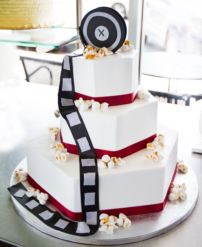 A movie themed wedding cake. but with teal or purple instead of red...