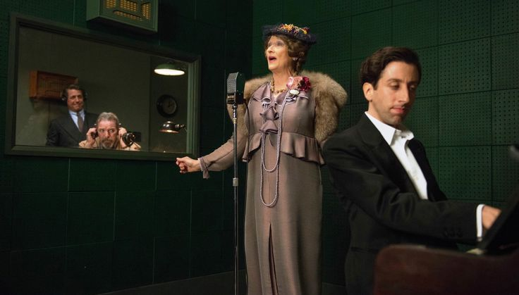 """Florence Foster Jenkins"" movie still, 2016.  L to R: Hugh Grant, Lloyd Hutchinson, Meryl Streep, Simon Helberg.  Florence Foster Jenkins was a real NY socialite who loved to sing despite having a voice that would peel paint.  This 2016 biopic earned Streep an Oscar nomination for Best Actress - her 22nd nomination overall (most in history by any performer)."
