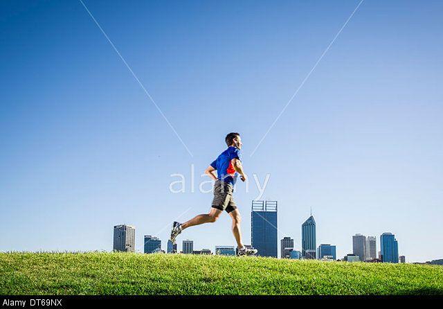 Mature male running through park, Perth, Australia