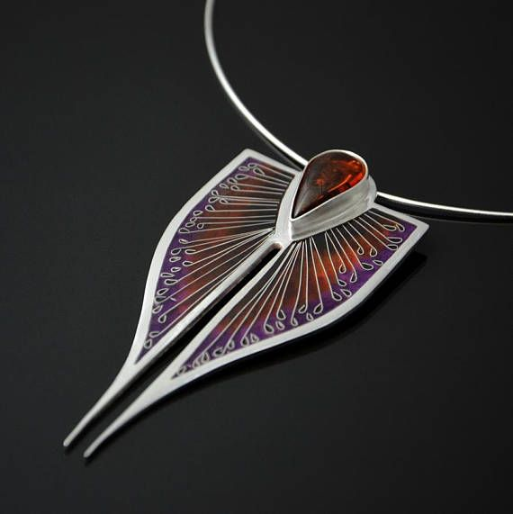 Silver pendant with Baltic amber with colorful ornament. The pattern is composed of violet shades going into brown colour. This colorful piece of pendant was made with an unusual technique - Georgian Minankari also known as Cloisonne. This is a traditional technique of decorating