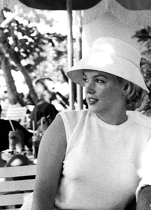 A casual hat of beige canvas designed with a wide brim. Possibly the same hat worn by Marilyn during her honeymoon in Jamaica with Arthur Miller. From the personal property of Marilyn Monroe.