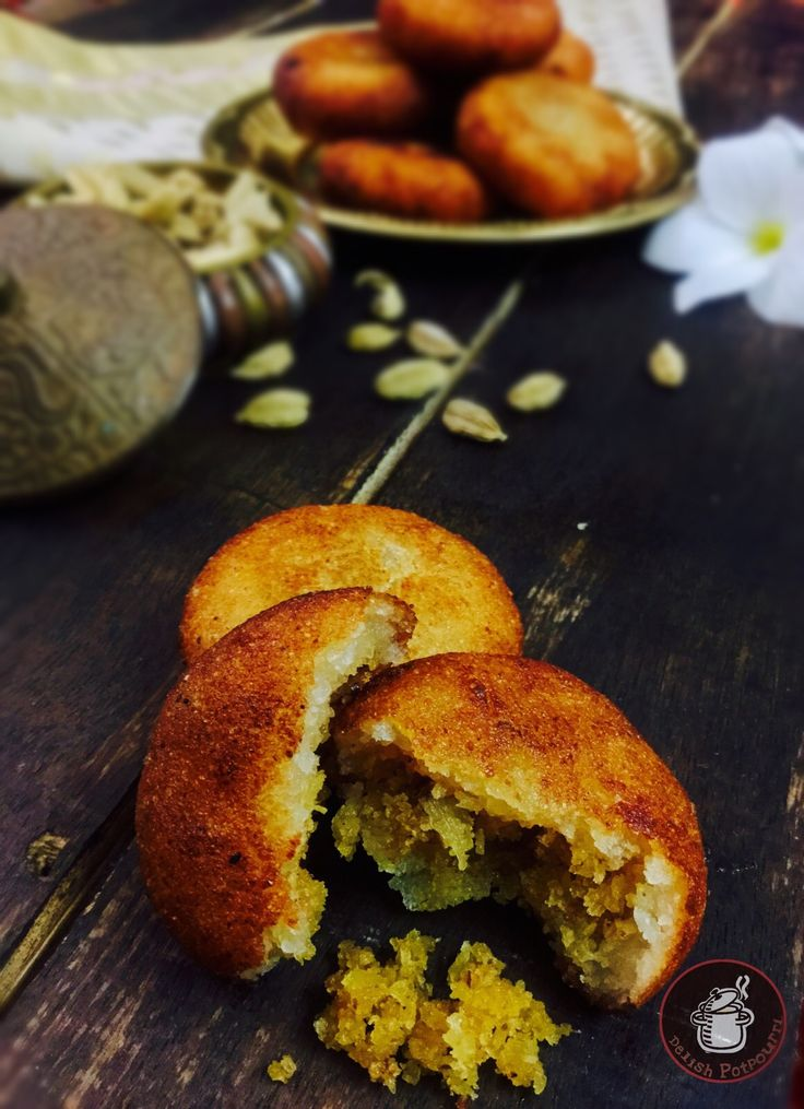Suji Manda Pitha/ Coconut Stuffed Semolina Dumplings Delicious and finger licking good Suji Manda Pithas, deep fried semolina dumplings stuffed with coconut and jaggery...authentic and traditional  Pitha made in festivals and special occasions in Odisha.