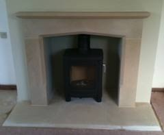 cotswold stone fireplace with wood burning stove